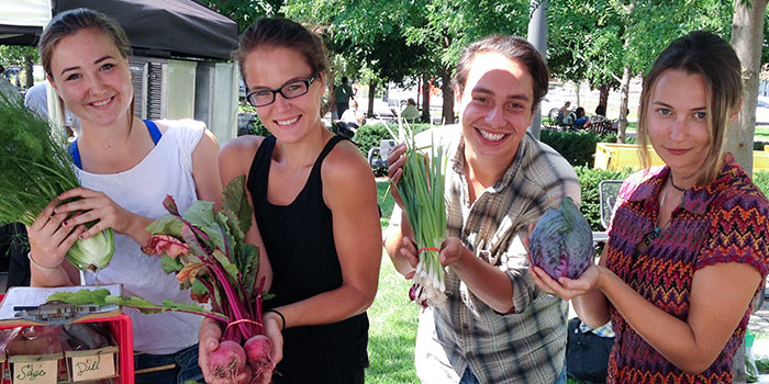 Students pose with the vegetables grown at the Cornercopia