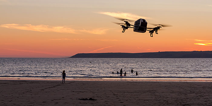 Drone flies over a beach