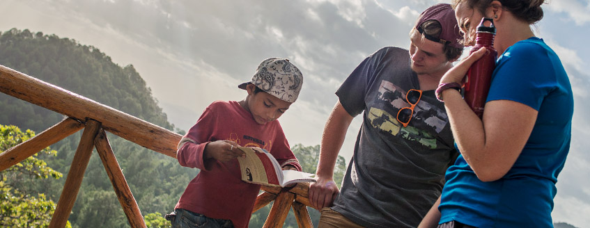 Students talk with a Nicaraguan boy