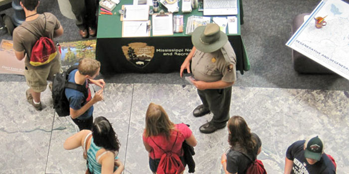 A Minnesota Ranger talks to students
