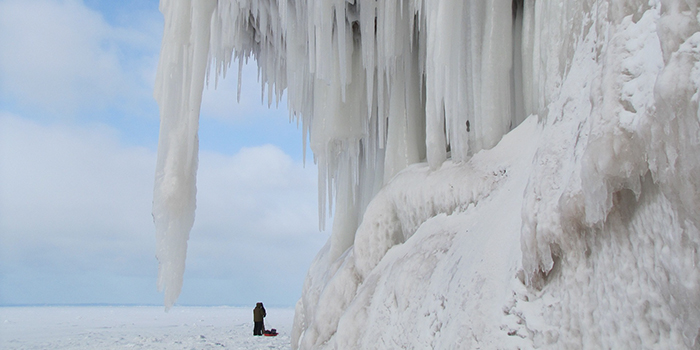 Winter ice caves, two people exploring