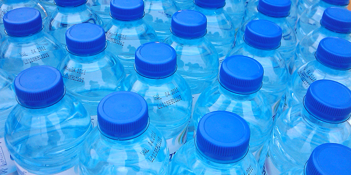 rows of blue plastic bottles with darker blue lids