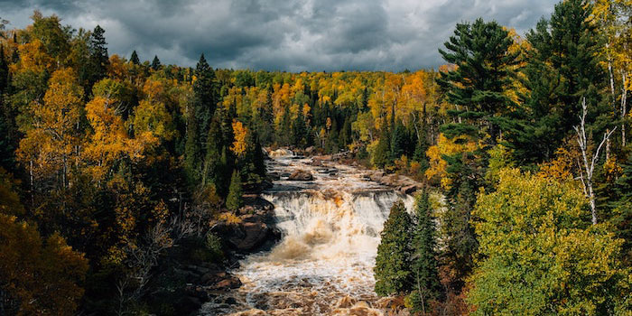 A waterfall on a cloudy fall day.