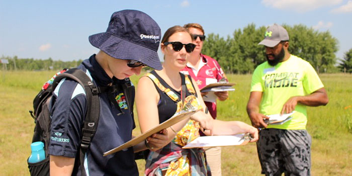 students look at clipboards