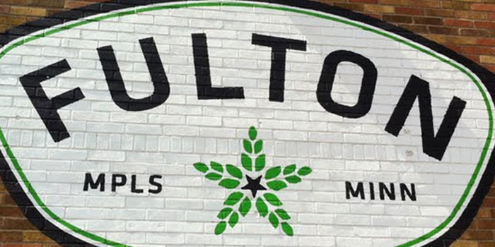 Fulton Brewery logo painted on brick wall
