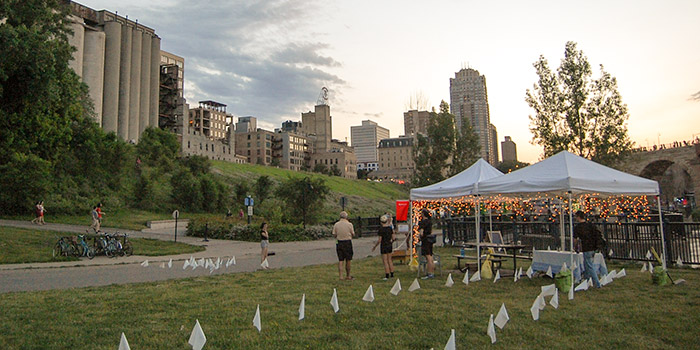 White tents in the stone arch area signify the meeting point for the surrender event