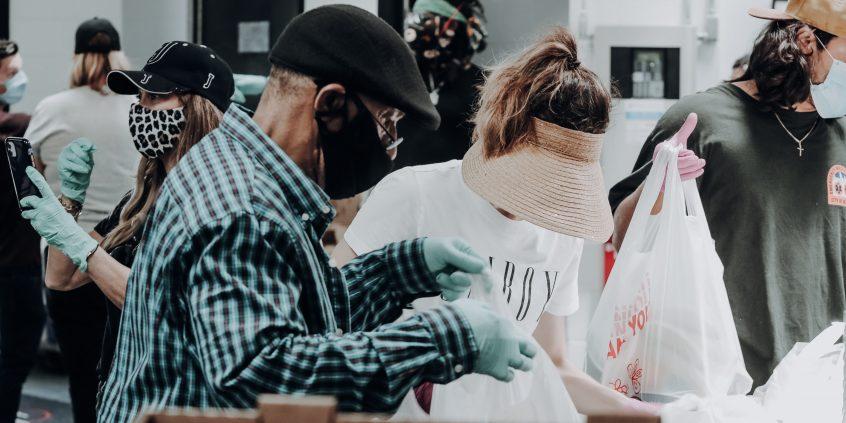Volunteers pack up food at a food shelf.